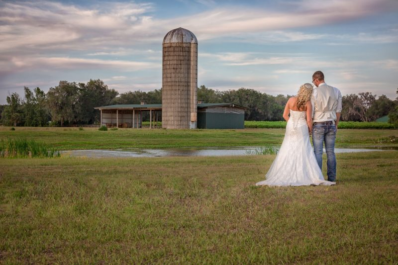 Bride and Groom standing in front of silo