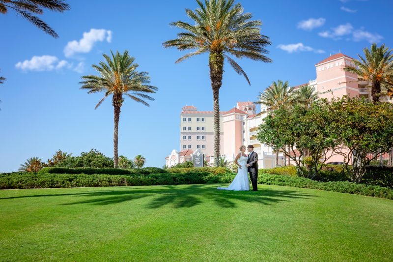 Bride and Groom in front of Hammock Beach Resort