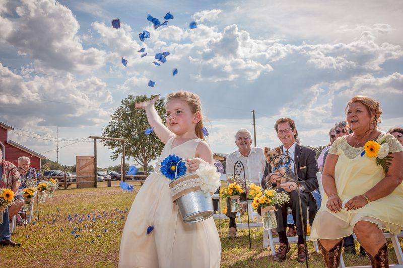 Flower girl throwing petals at wedding